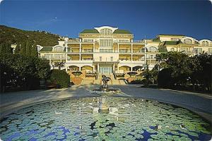 Отель «Пальмира Палас», Курпаты